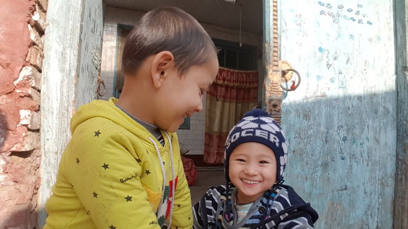 Two Uyghur children play outside of their home located in Kashgar's old city.